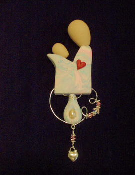 Mother and Child Pin- Handmade with Polymer Clay and Sterling Silver wire, findings and heart charm. Austrian Crystals are also used. Bar pin on the back. Jewelry box included. Unique and Beautiful for a Mother's Day Gift! Unique design, one-of-a-kind !100% handmade