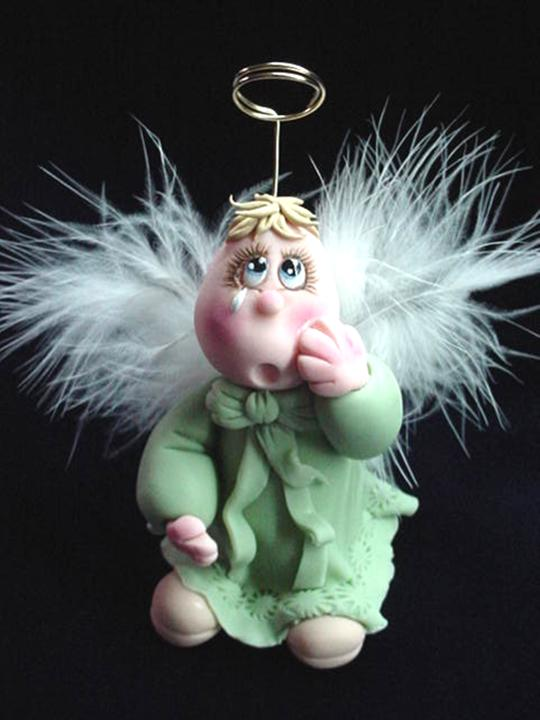 Porcelain Crying Angel Figurine-Handmade with porcelain. Every detail is hand molded piece by piece. Feathers and gold wire is used for final details. This unique piece is set up in a wooden base as final touch. One-of-a-kind design. Handmade Crafts.