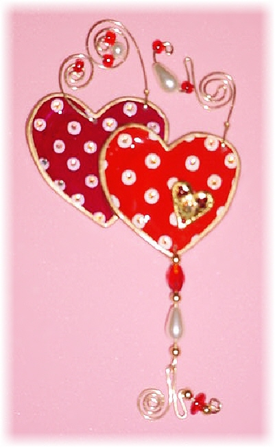 Valentine's Polka-Dots Hearts Pin: Dimensions: About 4.5 in x 2.5 in(including the beaded wires)Description: This porcelain handmade ornament is painted in bright colors and gold enamel details. Embellished w/AB and Ruby Austrian Crystals. Glass beads and pearls are used. Also, gold color wire is used for final details.Express your feelings with this unique gift! Retail Price: $25.50