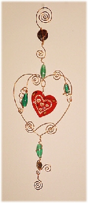 Seasonal Wire Heart Ornament- Dimensions: About 10.75 in x 8 in. Description: This handmade ornament is hand crafted in Copper with blown glass beads. Each detail is created based on the artist's perspective and creative freedom of expression. Beautiful for garden, terrace or home accent decor.Unique Design! Retail Price: $28.00