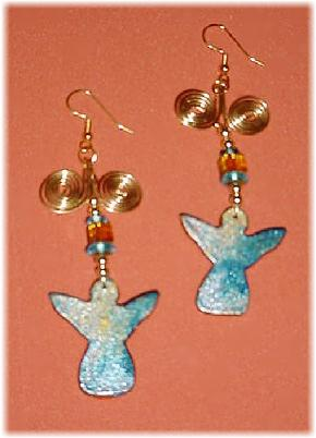 This porcelain handmade earrings set is painted in bright blue, gold and translucent colors. Glass  beads and gold plated wire and findings are used for final details. Very Unique!
