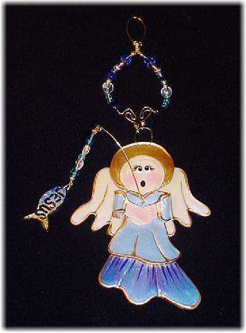 This porcelain handmade ornament is painted in translucent colors, antique gold paint and gold enamel details. AB Austrian Crystals, glass  beads and wire are used for final and hanging details. Oops! I got Jesus in the fish!