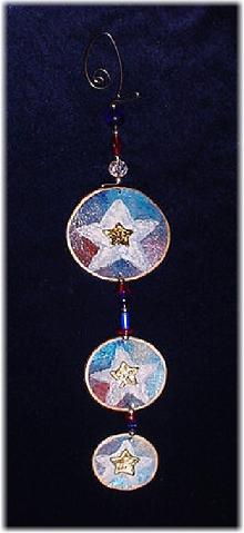 This porcelain handmade ornament is painted in glossy patriotic colors. Glass beads and wire are used for final details. Also, some foil effects are applied. Different and Unique!!!
