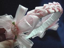 Handmade with satin ribbon, pearls and beads. Ribbon handmade roses are also applied for final details. Beautiful and unique designs to match any baby set.