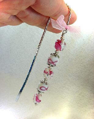 Cancer Awareness Bookmark - Handcrafted with a twisted metal bookmark, glass and silver beads and spacers. Pink organza ribbon. Because we have hope! Each bookmark comes in a suede black bag for protection and presentation. Just beautiful and tender!
