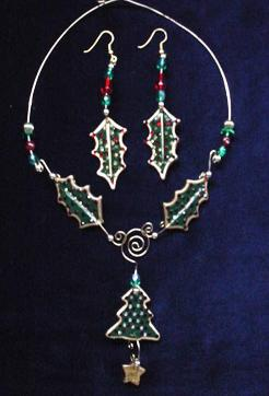 This porcelain handmade necklace is painted in glossy  green and gold enamel details.  Also,  some foil effects are applied. Austrian Crystals, glass beads and gold plated beads are used for final touches. Gold plated wire is used for final details. Earrings, are one set of two Leaves design.