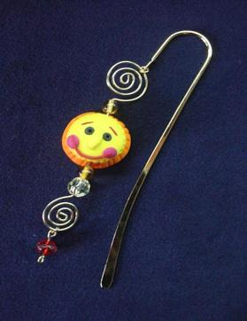 Handmade of glazed Fimo. Gold plated findings and wire are used for final details. Different, fun and functional! Unique designs for any taste! More designs will be available soon!