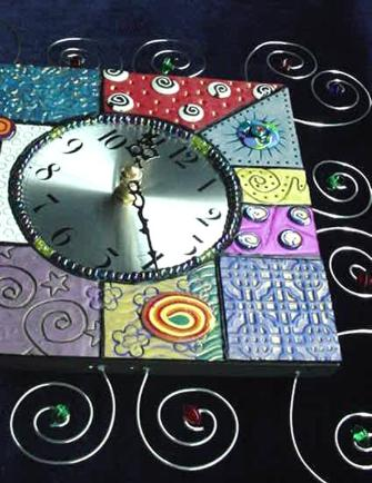 Textured Fimo and Wire Wall Clock - Handmade with  Fimo and Polymer Clay. Nickel  wire, glass beads and wood are used for final details. Quartz clock quality is used for the clock system. This clock will enhance any area in your home or office. One-of-a-kind. Unique Design!