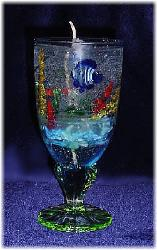 Large Gel Candle- Lt. Blue glass goblets. Gel wax and glass fish are used to embellish the gel candle. Dry flowers sticks are used to create the coral atmosphere. Zinc-cored wick for great and secure burning process. Unique designs!  All fragrances available! Specify the fragrance with your order. Thank you.