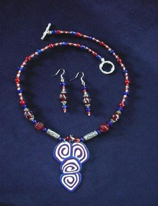 This beautiful set is made with patriotic colors (white, blue and red) glass beads. Necklace pendant is made of glazed Fimo. Pewter findings and clasps are added for final details. Very Patriotic and elegant!