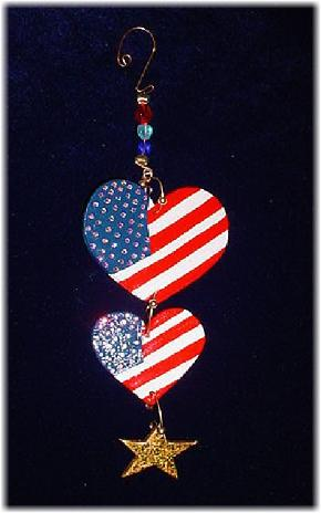This porcelain handmade ornament is painted in glossy patriotic colors. Also some foil effects are applied. Austrian crystals, glass beads and wire are used for final and hanging details.