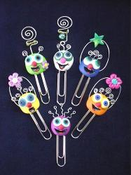Handmade with glazed Fimo. Silver wire, glass beads, tiny bells and large paper clips. Functional, colorful, funny and durable. Make everyone laugh with these funny 'Pimpollos' Faces! Some are also note holders.