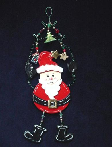 This porcelain handmade ornament is painted in pearly white, red and black bright colors. Gold enamel and foil effects are applied.  Each detail is set one by one. Green wire and glass beads are used for final details. Unique Design!