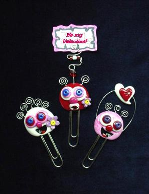 'Valentine's Paper Clips-Handmade with glazed Fimo. Silver wire, glass beads and large paper clips. Functional, colorful, funny and durable. Make everyone laugh with these funny Valentine's Pimpollo Faces! Some are also note holders.