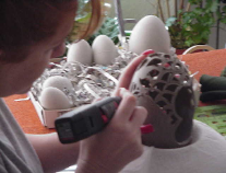 Mary creating, carving and designing an Eggypiece.