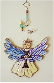 Guardian Angel Detail Image This porcelain handmade ornament is painted in translucent and gold enamel details. AB Austrian Flower Finding, Amethyst Austrian Crystals, glass  beads and wire are used for final and hanging details.