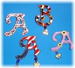 Display of different designs available.  Collect all 26 letters of the alphabet!
