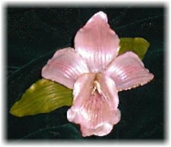 This porcelain handmade, hand-painted orchid pin  is painted in translucent light pink and gold enamel details. This beautiful pin comes in a box ready for display or to give. Unique design, one-of-a-kind ! 100% handmade